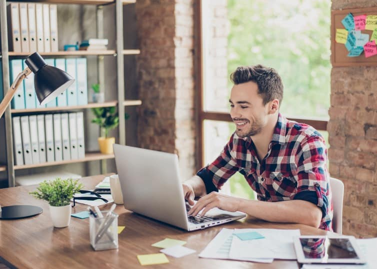 real estate agent writing blog on laptop