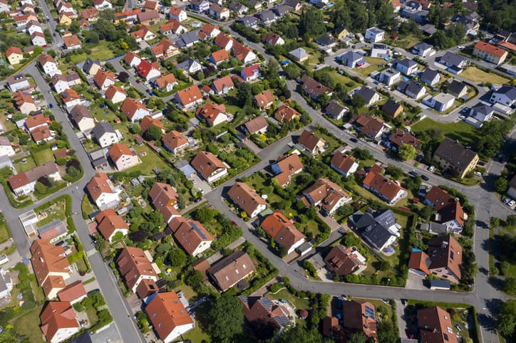 Aerial view above suburb homes in residential neighborhood