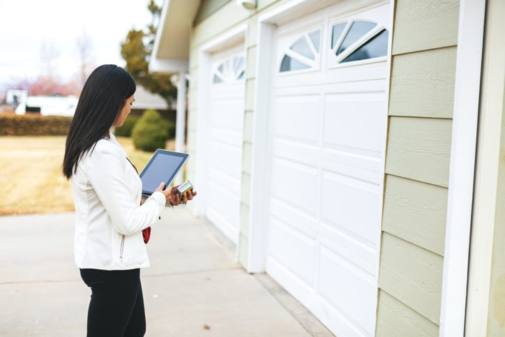 Female appraiser inspecting a single-family residential complex property