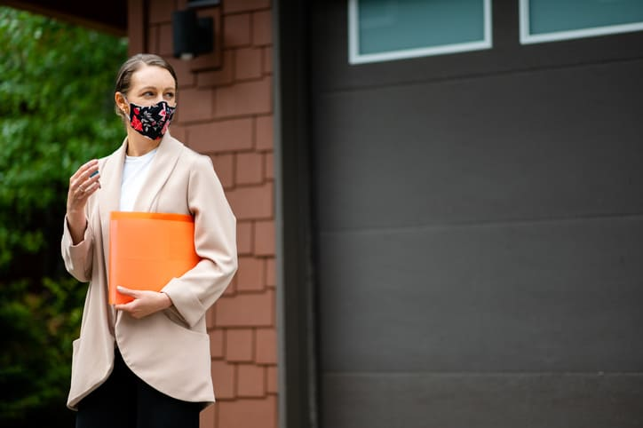 Residential appraiser wearing a face mask for COVID-19 safety.