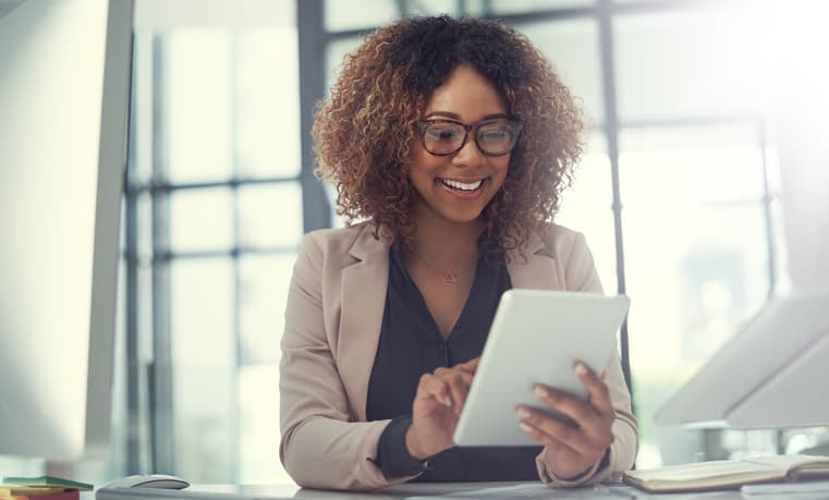 Young businesswoman using appraisal business software on a digital tablet