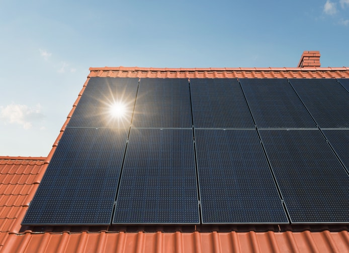 Solar panels on a residential rooftop on a sunny day